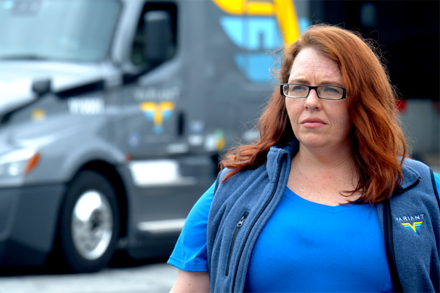 driver standing in front of parked truck